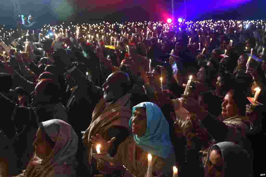 Pakistani Christians attend the candle light Carol service during the Christmas celebration in Lahore.