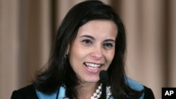 FILE - Goldman Sachs' Dina Powell, who served as Assistant Secretary for Educational and Cultural Affairs, speaks at the State Department, Jan. 6, 2006, in Washington.