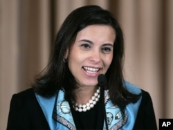 FILE - Dina Powell, Assistant Secretary for Educational and Cultural Affairs, speaks at the State Department, Jan. 6, 2006, in Washington.