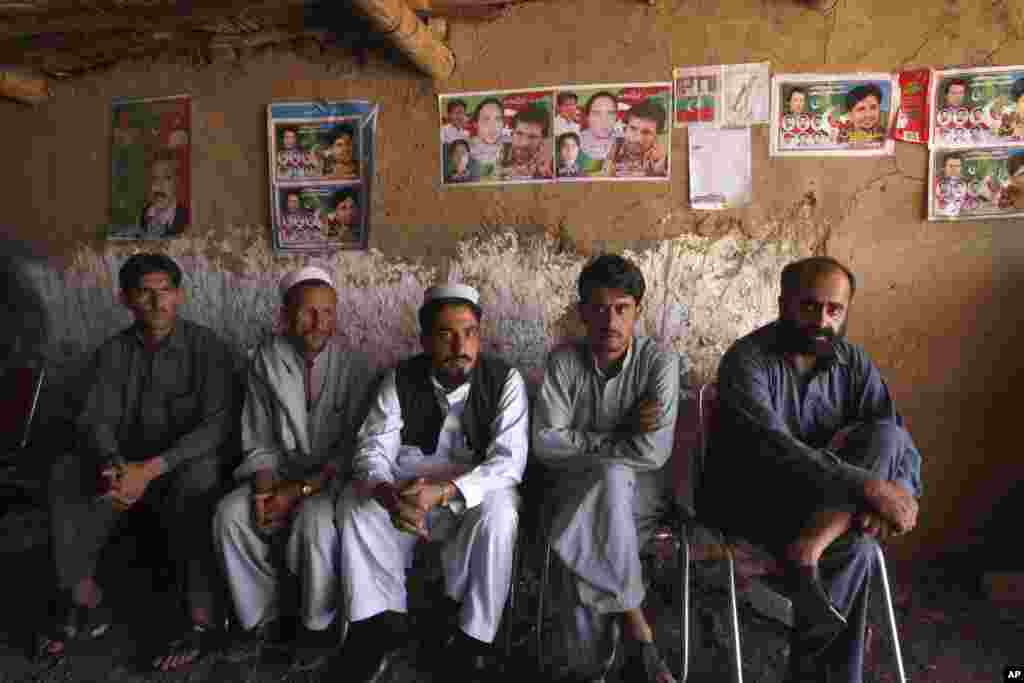 Supporters of Tehreek-e-Insaf, headed by Pakistan's cricket star-turned-politician Imran Khan, sit in a make-shift election office in the Jalozai camp in Peshawar, Pakistan, May 8, 2013.