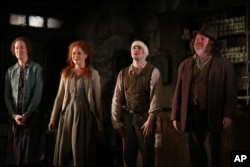 "From left, Ingrid Craigie, Sarah Greene, Daniel Radcliffe and Pat Shortt appear at the opening night curtain call of ""The Cripple of Inishmaan"" on April 20, 2014, in New York."