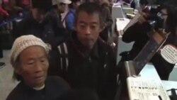 陳光誠母親和哥哥星期三離開北京赴美國