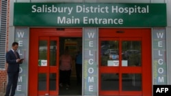 FILE - A general view shows the main entrance to Salisbury District Hospital, in Salisbury, southern England, July 4, 2018, where a British woman, Dawn Sturgess, poisoned with a nerve agent, died Sunday.
