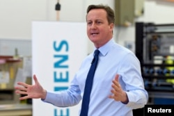 Britain's Prime Minister David Cameron speaks to factory staff at the Siemens plant in Chippenham, southern England, Feb. 2, 2016.