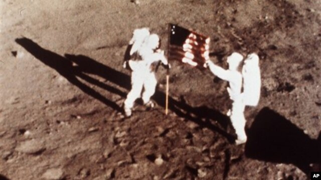 "Apollo 11 astronauts Neil Armstrong and Edwin ""Buzz"" Aldrin, the first men to land on the moon, plant the U.S. flag on the lunar surface on July 20, 1969"