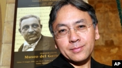 "Author Kazuo Ishiguro poses for a photo before receiving the ""Giuseppe Tomasi di Lampedusa"" prize for literature, in Santa Margherita Belice, near Palermo, Sicily, southern Italy, Saturday Aug. 8, 2009."