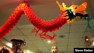 Chinatown restaurant dragon hovers above diners
