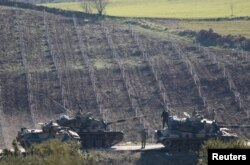 Turkish Army tanks are seen near the Turkish-Syrian border in Kilis province, Turkey Jan. 31, 2018.