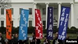 FILE - Opponents of the Trans-Pacific Partnership (TPP) trade agreement protest outside the White House in Washington, Feb. 3, 2016.
