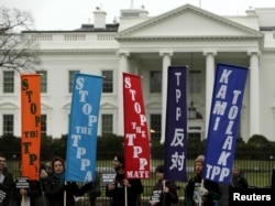 FILE - Opponents of the Trans Pacific Partnership (TPP) trade agreement protest outside the White House in Washington, Feb. 3, 2016.