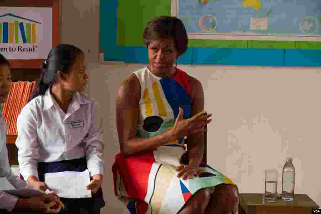 Michelle Obama speaks with a girl at Hun Sen Prasat Bakong Hight School, outside Siem Reap, March 21, 2015.