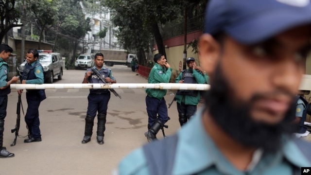Bangladeshi police stand guard in front of the house of former Prime Minister and main opposition Bangladesh Nationalist Party (BNP) leader Khaleda Zia during a 48-hour nationwide strike called by her party, in Dhaka, Bangladesh, Jan. 6, 2014.