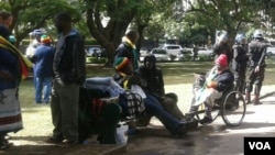 Police monitor protesters at Africa Unity Square.