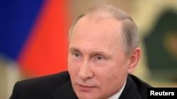 Prezidan Peyi Larisi a, Vladimir Putin.