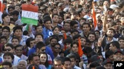 Indian cricket fans wait to enter the Sardar Patel Stadium, venue of the second Twenty20 cricket match between India and Pakistan, in Ahmadabad, India, December 28, 2012.