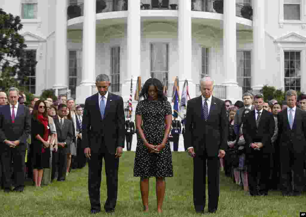 President Barack Obama, first lady Michelle Obama, Vice President Joe Biden, and others, stand on the South Lawn of the White House in Washington, as they observe a moment of silence to mark the 13th anniversary of the 9/11 attacks.