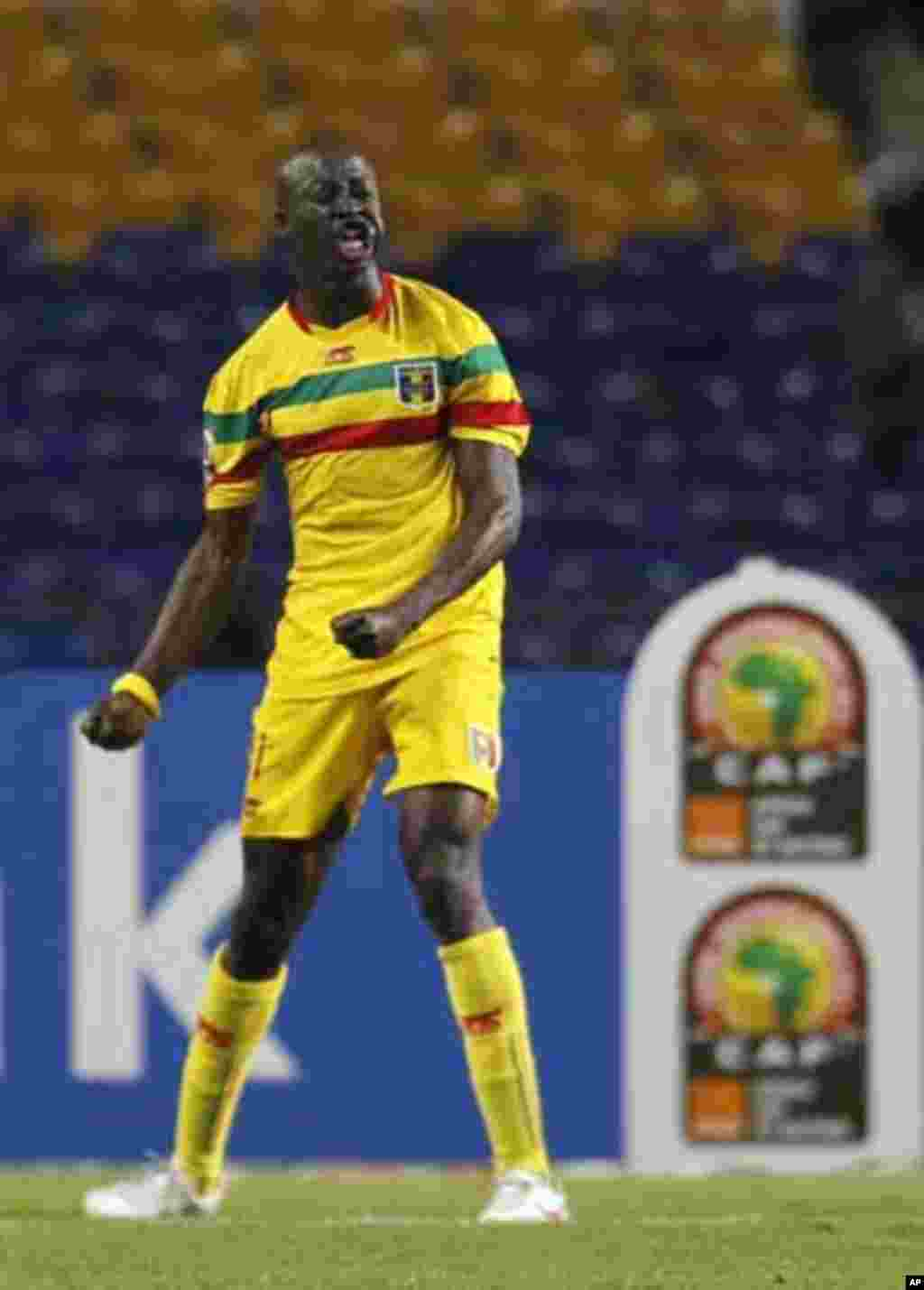 Mali's Garra Dembele celebrates his goal against Botswana during their final African Cup of Nations Group D soccer match at the Stade De L'Amitie Stadium in Libreville February 1, 2012.