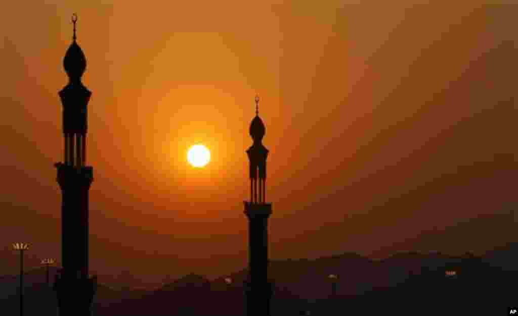 The minarets of Namira mosque are seen during prayers at sunset in Arafat near Mecca,, Saudi Arabia, Monday, Nov. 15, 2010. The annual Islamic pilgrimage draws 2.5 million visitors each year, making it the largest yearly gathering of people in the world.(