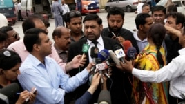 Prosecutor Chaudhry Zulfikar talks to journalists outside the anti-terrorism court (ATC) in Rawalpindi, in this picture taken April 26, 2013.