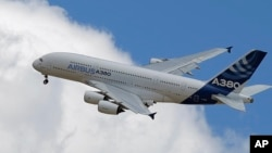 The Airbus A 380 performs its demonstration flight at the Paris Air Show, in Le Bourget airport, north of Paris, Friday, June 19, 2015. (AP Photo/Francois Mori)
