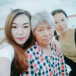中国湖北郧西访民柯大英及两个女儿(柯大英提供图片)