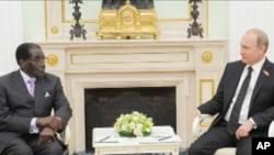 Zimbabwe President Robert Mugabe and Russian President Vladimir Putin in the Kremlin, in Russia