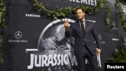 "Cast member Chris Pratt poses at the premiere of ""Jurassic World"" in Hollywood, California."