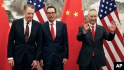 FILE - Chinese Vice Premier Liu He, right, gestures as U.S. Treasury Secretary Steven Mnuchin, center, chats with his Trade Representative Robert Lighthizer before their meeting in Beijing, May 1, 2019.