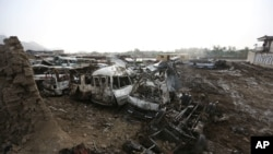 FILE - Destroyed cars are seen after an April 19 Taliban-claimed suicide attack in Kabul, Afghanistan, April 20, 2016. The attack, which killed nearly 70 people, pushed President Ashraf Ghani to take more resolute action against the miltant group.