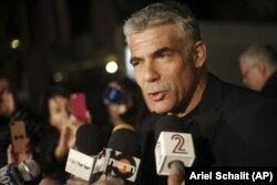 Yair Lapid, leader of Yesh Atid party gives a statement outside his home in Tel Aviv, Wednesday, Jan. 23, 2013.