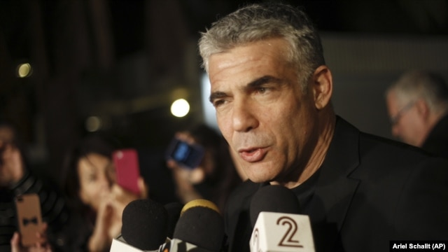 Yair Lapid, leader of Yesh Atid party gives a statement outside his home in Tel Aviv, Wednesday, Jan. 23, 2013.  (AP Photo/Ariel Schalit)