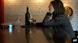 Many people who drink a lot of alcohol often smoke. Scientists explain the relationship between alcohol and cigarettes. It's complicated. (AP Photo/Darko Vojinovic)