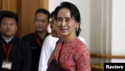 Myanmar's National League for Democracy leader Aung San Suu Kyi arrives to the opening of the new parliament in Naypyitaw February 1, 2016. After decades of struggle, hundreds of lawmakers from Aung San Suu Kyi's camp will form Myanmar's ruling party on M