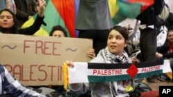 Demonstrators sit as around 100 pro-Palestinian activists stage a protest at Brussels national airport in Zaventem, Israel, early April 15, 2012.