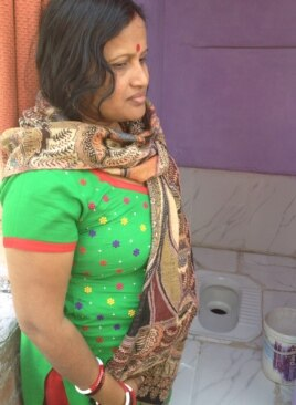 Poonam Sode's tiny, newly constructed latrine connected to a sewer line in a crowded slum in East Delhi has ended long waits at a community toilet and visits to a nearby open area.