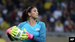 FILE - United States' goalkeeper Hope Solo takes the ball during a women's soccer game at the Rio Olympics against New Zealand in Belo Horizonte, Brazil, Aug. 3, 2016.