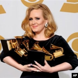Adele holds her Grammy Awards