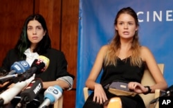 Pussy Riot member and the former wife of Pyotr Verzilov, Nadya Tolokonnikova, left, and Verzilov's girlfriend Veronica Nikulshina address the media during a press conference on the state of health of the member of the Russian Punk band Pussy Riot, Pyotr V