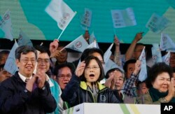 Taiwan's Democratic Progressive Party presidential candidate Tsai Ing-wen speaks to supporters during a large campaign rally in Kaohsiung, Taiwan, Saturday, Jan. 9, 2016. Taiwan will hold its presidential election on Jan. 16, 2016.