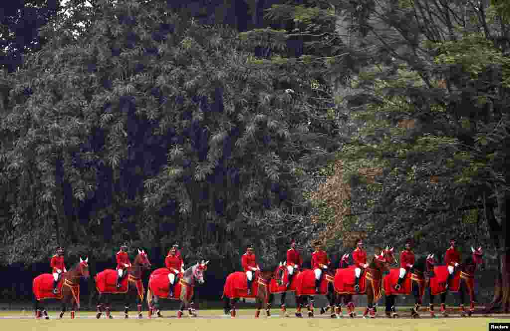A mounted honor guard takes part in the welcoming ceremony for Brunei's Sultan Hassanal Bolkiah at the palace in Bogor, south of Jakarta, Indonesia.
