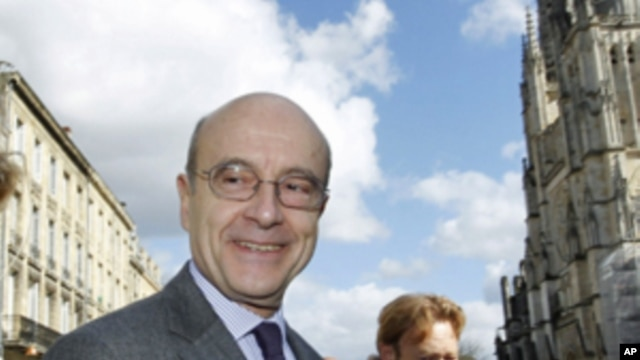 France's mayor of Bordeaux Alain Juppe arrives for a news conference as he was appointed France's foreign minister, February 28, 2011