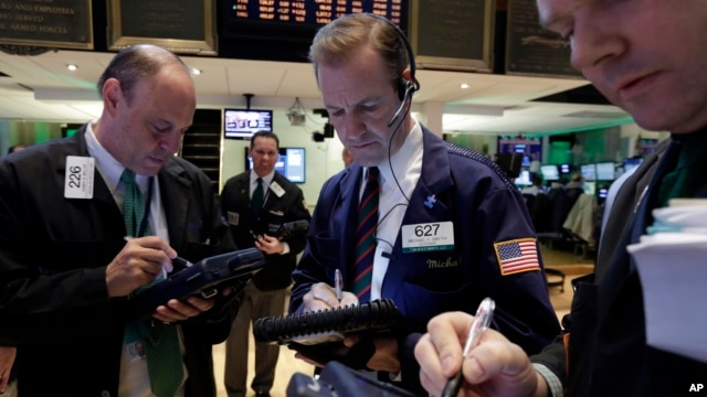 Traders work on the floor of the New York Stock Exchange, March 17, 2014.