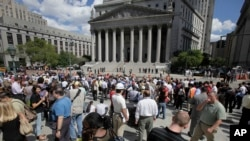 People stand in Foley Square in New York after being evacuated from the Federal and State buildings that surround it Tuesday, Aug. 23, 2011. The 5.8 magnitude earthquake centered northwest of Richmond, Va., shook much of Washington, D.C., and was felt as far north as Rhode Island and New York City.