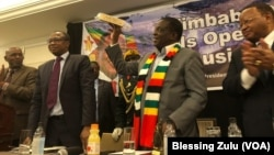 iimbabwe President Emmerson Mnangwagwa. Also in the picture, Zimbabwe Ambassador to the U.S. Ammon Mutembwa (far left); Finance Minister Mthuli Ncube (left) and Zimbabwe Ambassador to the UN Frederick Shava.