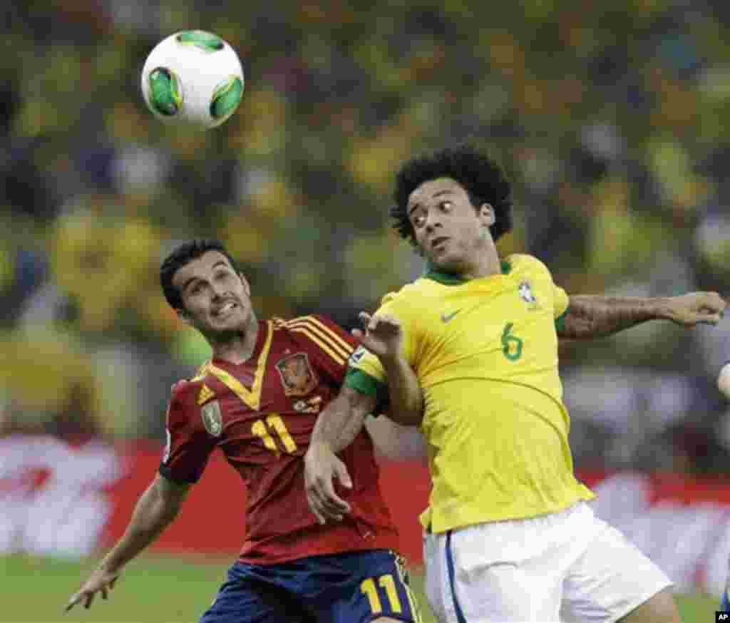 Spain's Pedro Rodriguez, left, and Brazil's Marcelo fight for the ball during the soccer Confederations Cup final match at the Maracana stadium in Rio de Janeiro, Brazil, Sunday, June 30, 2013. (AP Photo/Natacha Pisarenko)