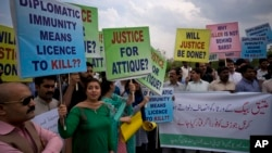 FILE - Pakistani protesters stage a rally demanding a trial for American diplomat involved in a vehicle crash that killed a person, in Islamabad, Pakistan, April 10, 2018.