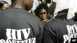 Protestors demand free HIV/AIDS treatment for persons living with HIV in Abuja, Nigeria (Dec 5, 2005). (George Osodi / AP Photo)