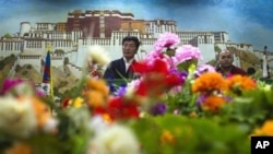 Prime Minister of the Tibetan government-in-exile, Lobsang Sangay, left, in Dharmsala, India, Sept. 25, 2012.