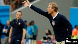 U.S. coach Juergen Klinsmann gives instructions to his players during their 2014 World Cup Group G soccer match against Portugal at the Amazonia arena in Manaus, Brazil, June 22, 2014.
