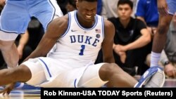 Feb 20, 2019; Durham, NC, USA; Duke Blue Devils forward Zion Williamson (1) reacts after falling during the first half against the North Carolina Tar Heels at Cameron Indoor Stadium.